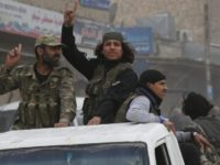 Turkey backed opposition fighters of the Free Syrian Army patrol the northwestern city of Afrin, Syria, during a Turkish government organised media tour into northern Syria, Saturday, March 24, 2018. Turkey and allied Syrian opposition fighters captured the city of Afrin on Sunday, March 18, nearly two months after the …