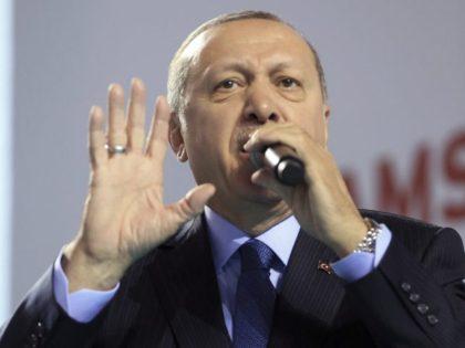 Turkey's President Recep Tayyip Erdogan addresses the members of his ruling party in Samsun, Turkey, Saturday, March 24, 2018. Erdogan has criticized anti-war students at a top university, calling them terrorists following a fight there. (Murat Cetinmuhurdar/Pool Photo via AP)