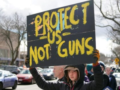 Student Gun Protests Idaho Sixth grader Violet Feigenbutz holds a sign during a March For Our Lives protest, Saturday, March 24, 2018, in Moscow, Idaho. (Kai Eiselein/The Moscow Pullman Daily News via AP)