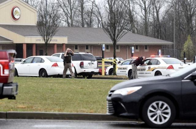 Kentucky police kill suspect in wife's death outside school