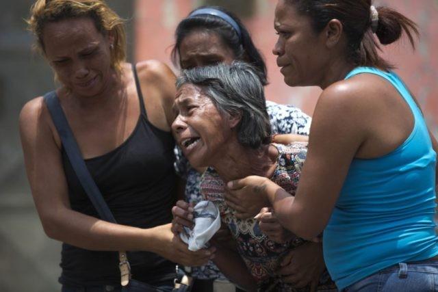 Relatives demand answers after Venezuela jail fire kills 68