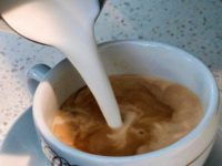 In this Sept. 22, 2017, file photo, a barista pours steamed milk in a coffee at a cafe in Los Angeles. Superior Court Judge Elihu Berle has ruled that California law requires coffee companies to carry an ominous cancer warning label because of a chemical produced in the roasting process. …