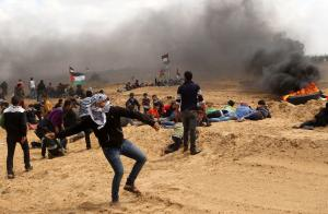 12 dead as Israelis, Palestinians clash in Gaza protest