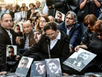 People hold portraits of Armenian intellectuals - who were detained and deported in 1915 - during a rally on Istiklal Avenue in Istanbul on April 24, 2018, held to commemorate the 103nd anniversary of the 1915 mass killing of Armenians in the Ottoman Empire. - Armenians say up to 1.5 …