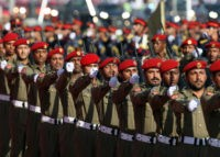 Qatari armed forces take part in a military parade during the Qatar National Day celebrations in Doha on Saturday, Dec ,18, 2010. (AP Photo/Osama Faisal)