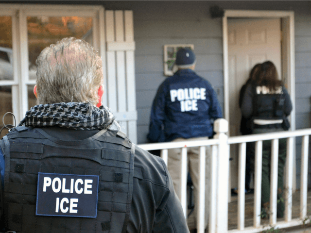 In this Feb. 9, 2017, photo provided U.S. Immigration and Customs Enforcement, ICE agents at a home in Atlanta, Ga.
