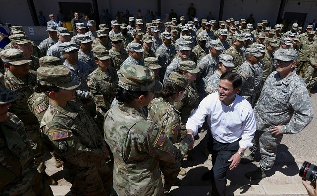 Arizona Governor Doug Ducey meets with his state's National Guardsmen who are being deployed to the border. (AP Photo: Ross D. Franklin)