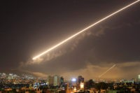 Damascus skies erupt with service to air missile fire as the U.S. launches an attack on Syria targeting different parts of the Syrian capital Damascus, Syria, early Saturday, April 14, 2018. Syria's capital has been rocked by loud explosions that lit up the sky with heavy smoke as U.S. President …