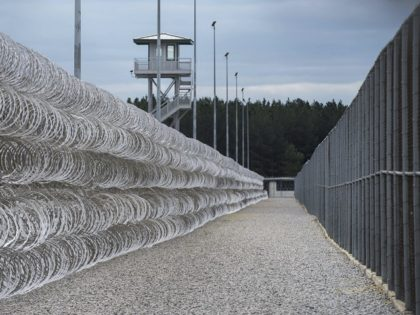 FILE - In this Feb. 9, 2016, file photo, razor wire protects a perimeter of the Lee Correctional Institution in Bishopville, S.C. A South Carolina prisons spokesman says several inmates are dead and others required outside medical attention after hours of fighting inside the maximum security prison. (AP Photo/Sean Rayford, …