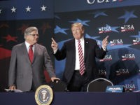 President Donald Trump, center, gestures as he is introduced before speaking at an event to promote his $1.5 trillion tax cut package at Bucky Dent Park in Hialeah, Fla., Monday, April 16, 2018. Looking on are Maximo Alvarez, left, CEO, Sunshine Distributor and Irina Vilarino, right, owner, Las Vegas Cuban …