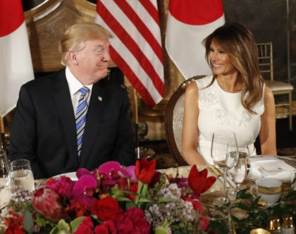 President Donald Trump and first lady Melania Trump smiles at each other as they host Japanese Prime Minister Shinzo Abe and his wife Akie Abe for dinner at Trump's private Mar-a-Lago club, Wednesday, April 18, 2018, in Palm Beach, Fla. (AP Photo/Pablo Martinez Monsivais)