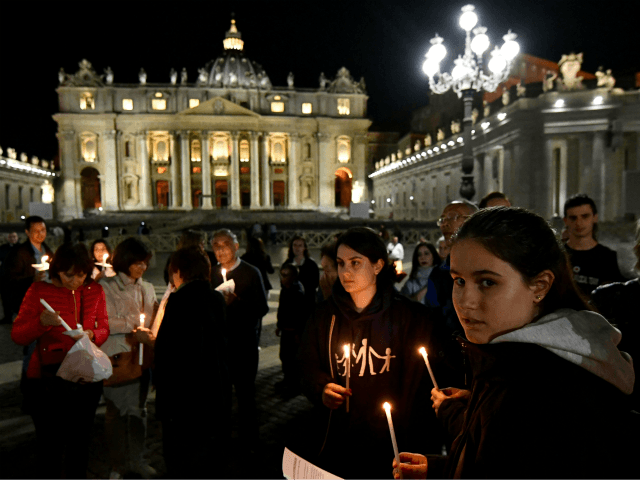 Members of the Italian association Comitato Articolo 26 take part in the Novena vigil prayer, praying for terminally ill British boy Alfie Evans, at the St Peter's square in Vatican, on April 26, 2018. (Photo by Alberto PIZZOLI / AFP) (Photo credit should read ALBERTO PIZZOLI/AFP/Getty Images)