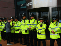 Police block the entrance to Alder Hey childrens hospital in Liverpool, northwest England as supporters of British toddler Alfie Evans try to storm the hospital following the announcement that the European court of human rights refused to intervene in his case on April 23, 2018. - Alfie Evans, who is …
