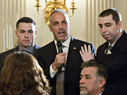 Andrew Pollack, whose daughter Meadow was one of the 17 people killed at Marjory Stoneman Douglas High School, center, speaks during a listening session with U.S. President Donald Trump, not pictured, on gun violence with high school students, teachers and parents in the State Dining Room of the White House …