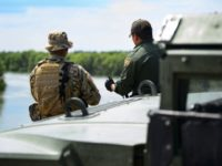 Texas National Guardsman meets with Border Patrol agent in Starr County. (Texas Military Department Photo: Sgt. Mark Otte)