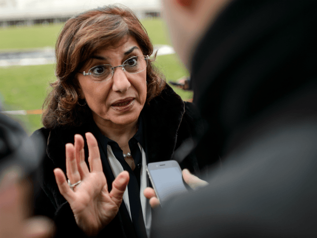 Syrian senior presidential advisor Buthaina Shaaban gestures as she answers a question from a journalist on Syrian peace talks at the United Nations on January 29, 2014 in Geneva. Syria's opposition said peace talks with President Bashar al-Assad's regime in Geneva took a step forward on January 29 with discussions …