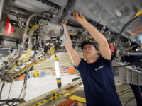 BRISTOL, ENGLAND - NOVEMBER 19: A skilled fitter works on the spoiler of a A400M at the Airbus aircraft manufacturer's Filton site on November 19, 2015 in Bristol, England. The site at Filton's main role is the designing and manufacture of wings, fuel and landing gear systems for all ranges …