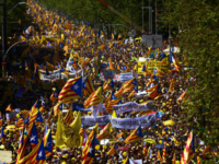 Demonstrators wave esteladas or independence flags in Barcelona, Spain, Sunday, April 15, 2018, during a protest in support of Catalonian politicians who have been jailed on charges of sedition. Tens of thousands of Catalan separatists rallied in downtown Barcelona Sunday to demand the release of high-profile secessionist leaders being held …