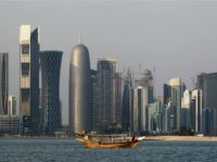 FILE - In this Thursday Jan. 6, 2011 file photo, a traditional dhow floats in the Corniche Bay of Doha, Qatar, with tall buildings of the financial district in the background. Qatar's government says it is forming a committee to pursue compensation for damages stemming from its isolation by four …