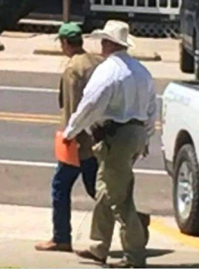 San Jacinto County Sheriff Greg Capers escorts arrested County Judge John Lovett from the courthouse to the jail. (Photo: San Jacinto County News)