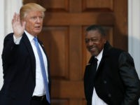 FILE - In this Nov. 20, 2016 file photo, President-elect Donald Trump stands with BET founder Robert Johnson at the Trump National Golf Club Bedminster clubhouse in Bedminster, N.J.. Johnson is one of dozens of people who have paraded into Trump's properties in New York and New Jersey in recent …