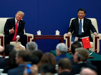 U.S. President Donald Trump gestures to his delegation next to and Chinese President Xi Jinping during a business event at the Great Hall of the People in Beijing, Thursday, Nov. 9, 2017. Trump is on a five-country trip through Asia traveling to Japan, South Korea, China, Vietnam and the Philippines. …