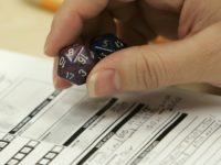 Dungeons & Dragons player holding dice