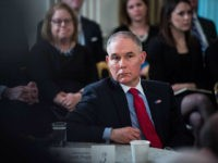 WASHINGTON, DC - FEBRUARY 26: Environmental Protection Agency Administrator Scott Pruitt listens as President Donald Trump speaks during a meeting with the members of the National Governors Association in the State Dining Room of the White House in Washington, DC on Monday, Feb. 26, 2018. (Photo by Jabin Botsford/The Washington …