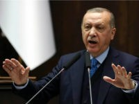 Turkish President and leader of the Justice and Development Party (AK Party) Recep Tayyip Erdogan gestures as he delivers a speech during the AK Party's parliamentary group meeting at the Grand National Assembly of Turkey (TBMM) in Ankara, on April 24, 2018. (Photo by ADEM ALTAN / AFP) (Photo credit …