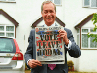 WESTERHAM, ENGLAND - JUNE 23: Nigel Farage, leader of UKIP and Vote Leave campaigner holds up the 'Daily Express' as he returns to his home after buying newspapers of the United Kingdom on June 23, 2016 in Westerham, England. The United Kingdom is going to the polls to decide whether …