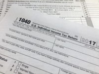 "An IRS 1040 form, U.S. Individual Income Tax Return, is shown on Thursday, April 5, 2018, in New York. Leading automated financial advisers — often called ""robo-advisers"" — such as Wealthfront and Betterment tout daily tax-loss harvesting as a way to significantly increase your returns. But independent research suggests the …"