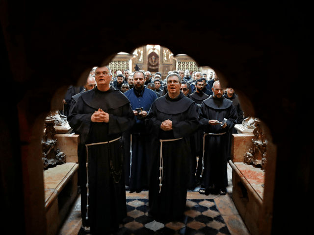 Father Francesco Patton (2-R), a superior in the Franciscan order known as 'Custo', and friars prays in front of the entrance of the Tomb of Jesus, where Jesus Christ is believed to be buried, inside the Church of the Holy Sepulchre at the end of the weekly Via Dolorosa (Way …