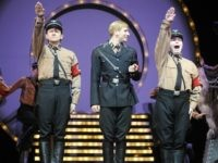 Dancers dressed as Nazi SS officers perform during the 'Springtime for Hitler' number of the musical 'The Producers' at Berlin's Admiral's Palast theatre May 14, 2009. The German premiere will take place on May 17. 'The Producers' began as a film by Jewish-American comedian Mel Brooks in 1968 which he …