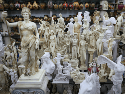 ATHENS, GREECE - FEBRUARY 19: Replica models of ancient Greek statues on display in a souvenir shop beneath the Acropolis on February 19, 2012 in Athens, Greece. Following a meeting on Wednesday, finance ministers across the Eurozone are calling for greater scrutiny and oversight of Greece's proposed budget cuts in …