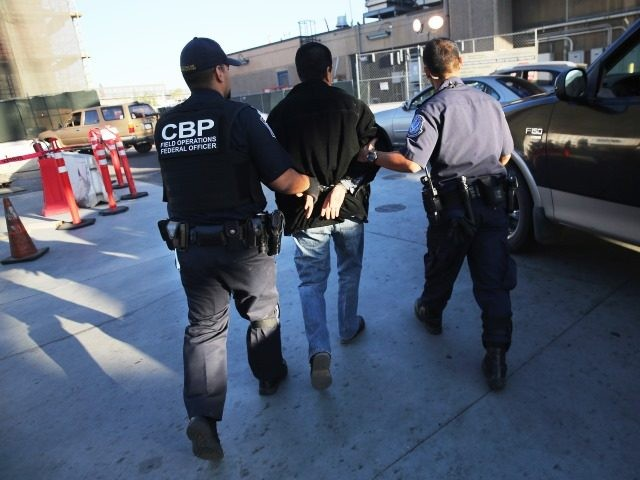 CBP officers arrest suspected drug smuggler. (File Photo: John Moore/Getty Images)