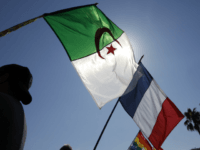 People wave the French and Algerian flags during a demonstration against a municipal order banning the 'conspicuous showing' of foreign flags issued by French right-wing UMP mayor of Nice Christian Estrosi (not pictured), following Algeria's fans celebrations during the 2014 FIFA World Cup, on July 05, 2014, in Nice, southeastern …