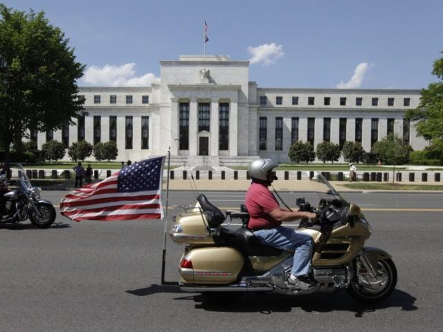 Motorcycclist participating in the The Rolling Thunder First Amendment Demonstration Run ride by the Federal Reserve Building in Washington, DC, on May 24, 2015. The Rolling Thunder First Amendment Demonstration Run is an annual event to pay tribute to current and former US military members. AFP PHOTO / CHRIS KLEPONIS …