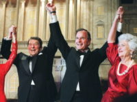 WASHINGTON, DC - NOVEMBER 5: US President Ronald Reagan (l) raises his arms in the air with presidential hopeful George Bush (2nd-r) after President Reagan announced endorsement for Bush as the next president of the United States in Washington DC, 05 November 1988. At left, First Lady Nancy Reagan, at …