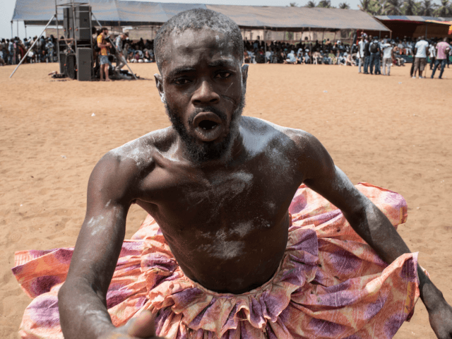 A Vodoo devotee dressed up in a costume performs at the annual Voodoo Festival on January 10, 2017 in Ouidah. Officially declared a religion in Benin in 1996, Voodoo and the Voodoo festival attracts thousands of devotees and tourists for a day filled with ritual dances and gin drinking. Benins …