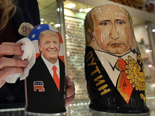 An employee polishes traditional Russian wooden nesting dolls, Matryoshka dolls, depicting US President-elect Donald Trump (L) and Russian President Vladimir Putin at a gift shop in central Moscow on January 16, 2017, four days ahead of Trump's inauguration. / AFP PHOTO / Alexander NEMENOV (Photo credit should read ALEXANDER NEMENOV/AFP/Getty …