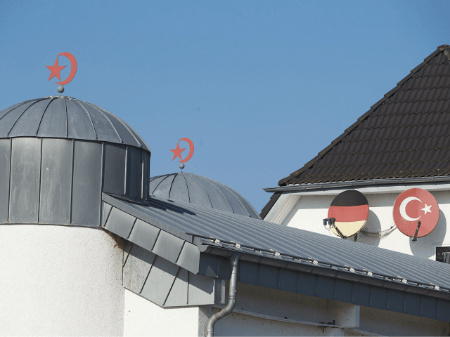 The roof of a mosque is pictured in Fuerthen, western Germany, on February 15, 2017. In connection with investigations against the Ditib mosque association on suspicion of espionage, German police searched the homes of four Turkish Muslim preachers on suspicion they spied for the government of President Recep Tayyip Erdogan, …