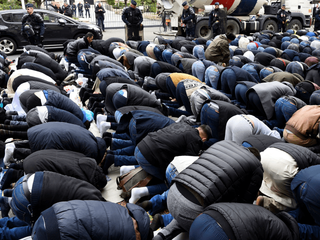 Muslims pray in the street during a protest in front of the city hall of Clichy, near Paris, on March 24, 2017, after an unauthorised place of worship was closed by local authorities. / AFP PHOTO / BERTRAND GUAY (Photo credit should read BERTRAND GUAY/AFP/Getty Images)