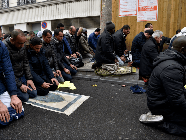 People pray in a street on November, 10, 2017, in Clichy, near Paris, while the city mayor demonstrate with others political leaders against muslim streets prayers. Muslim worshipers pray every friday on a small square in front of the Clichy's town hall to protest againt the closure of a Muslim …