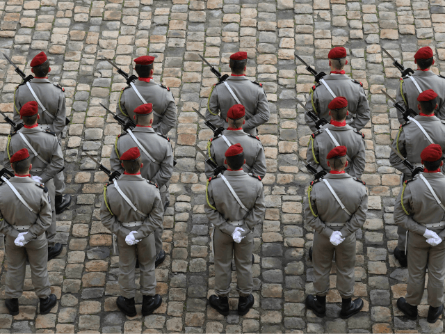 Soldiers stand during the National Tribute ceremony for late member of the Academie Francaise Jean d'Ormesson at the Invalides in Paris on December 8, 2017. / AFP PHOTO / ludovic MARIN (Photo credit should read LUDOVIC MARIN/AFP/Getty Images)