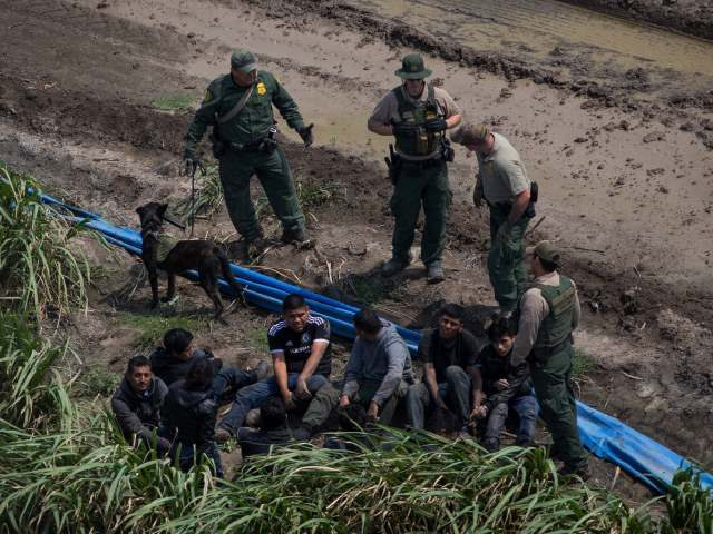 Border Patrol agents apprehend illegal immigrants near the US border with Mexico on, March 27, 2018 in the Rio Grande Valley Sector, near McAllen, Texas.