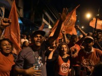 Supporters of Brazilian former president Luiz Inacio Lula da Silva gather in front of his house in Sao Bernardo do Campo, Sao Paulo state, Brazil as the Supreme Court of Justice in the capital, deliberates on whether he should start a 12 year prison sentence for corruption, on April 4, …