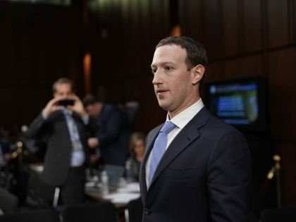 Facebook co-founder, Chairman and CEO Mark Zuckerberg returns to the witness table after taking a brief break while testifying before a combined Senate Judiciary and Commerce committee hearing in the Hart Senate Office Building on Capitol Hill April 10, 2018 in Washington, DC. Zuckerberg, 33, was called to testify after …