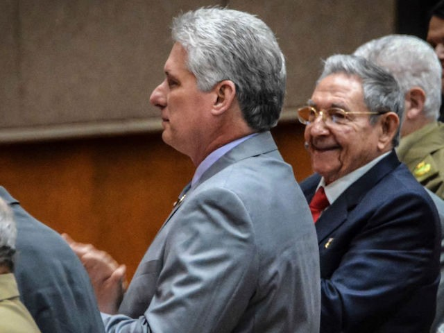 Cuban President Raul Castro (R) smiles and applaud as First Vice-President Miguel Diaz-Canel is named as the candidate to succeed him as president, during a National Assembly session in Havana on April 18, 2018. Miguel Diaz-Canel is the sole candidate to succeed Cuba's President Raul Castro, officials announced Wednesday on …