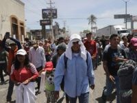 'Caravan Migrants' Waiting to Cross after Arrival South of U.S. Border