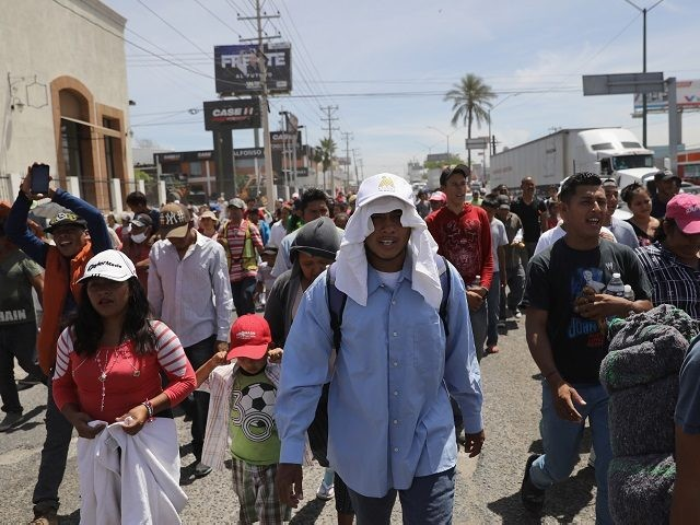 """HERMOSILLO, MEXICO - APRIL 23: Central American immigrants, part of an immigrant """"caravan,"""" march in protest against U.S. President Donald Trump on April 23, 2018 in Hermosillo, Mexico. They demonstrated against Trump's morning tweets calling for U.S. Homeland Security to stop them from crossing the border into the United States …"""